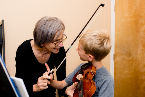 Melody Rike viola violin instructor with student