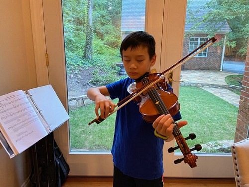 student playing violin